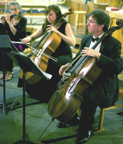 Sherman Chamber Ensemble founders Eliot Bailen on cello, foreground, and Susan Rotholz on flute perform with cellist Jennifer DeVore as the Sherman Chamber Ensemble celebrates its 30th season in 2012. Photo: Trish Haldin