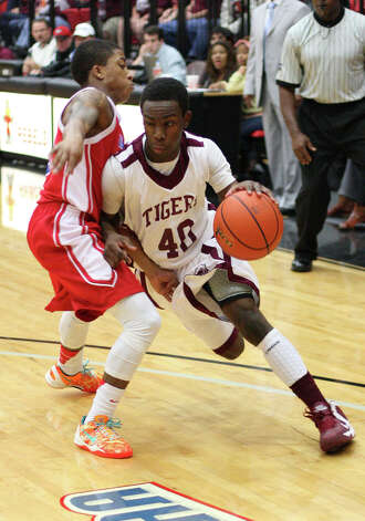 Silsbee?s Zayon Jackson, No. 40, drives to the basket during the Class 3A playoff game against Houston Kashmere Friday in the Lee College Sports Arena and Wellness Center in Baytown, TX. (Matt Billiot / Special to the Enterprise)