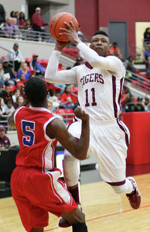 Silsbee?s Jordan Holmes, No. 11, attempts a layup during the Class 3A playoff game against Houston Kashmere Friday in the Lee College Sports Arena and Wellness Center in Baytown, TX. (Matt Billiot / Special to the Enterprise)