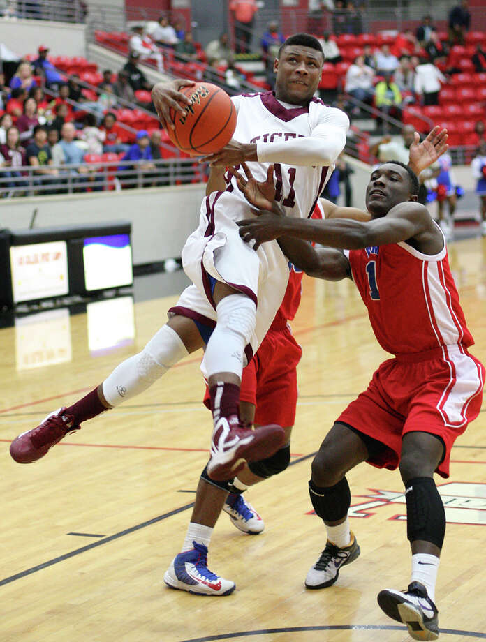 Silsbee's Jordan Holmes, No. 11, is fouled on a shot during the Class 3A playoff game against Houston Kashmere Friday in the Lee College Sports Arena and Wellness Center in Baytown, TX. (Matt Billiot / Special to the Enterprise)