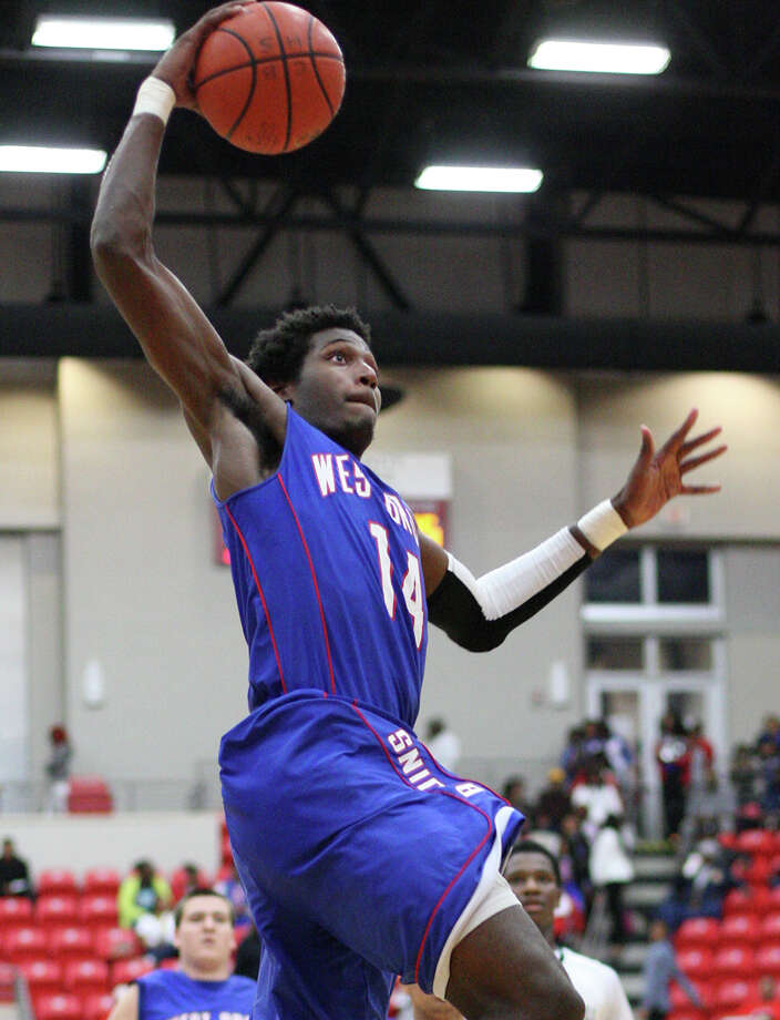 West Brook?s Michael Zeno, No. 14, goes up for a dunk during the Class 5A playoff game against Clear Brook Friday in the Lee College Sports Arena and Wellness Center in Baytown, TX. (Matt Billiot / Special to the Enterprise)
