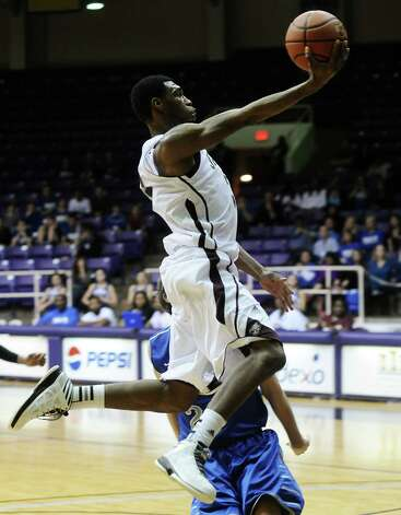 Central player Andre' Morris, #32, puts it up for two during the Georgetown High School Class 4A area round playoff game against Central High School at Prairie View  A&M University on Friday, February 22, 2013.  Georgetown won over Central 41 - 37. Photo taken: Randy Edwards/The Enterprise Photo: Randy Edwards