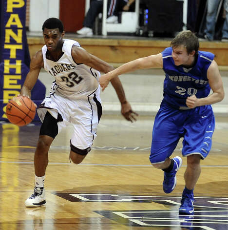 Central player Andre' Morris, #32, drives down the court during the Georgetown High School Class 4A area round playoff game against Central High School at Prairie View  A&M University on Friday, February 22, 2013.  Georgetown won over Central 41 - 37. Photo taken: Randy Edwards/The Enterprise Photo: Randy Edwards