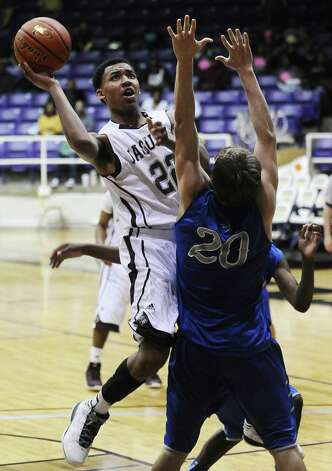 Central player Nijal Pearsonn, #22, puts it up for two during the Georgetown High School Class 4A area round playoff game against Central High School at Prairie View  A&M University on Friday, February 22, 2013.  Georgetown won over Central 41 - 37. Photo taken: Randy Edwards/The Enterprise Photo: Randy Edwards