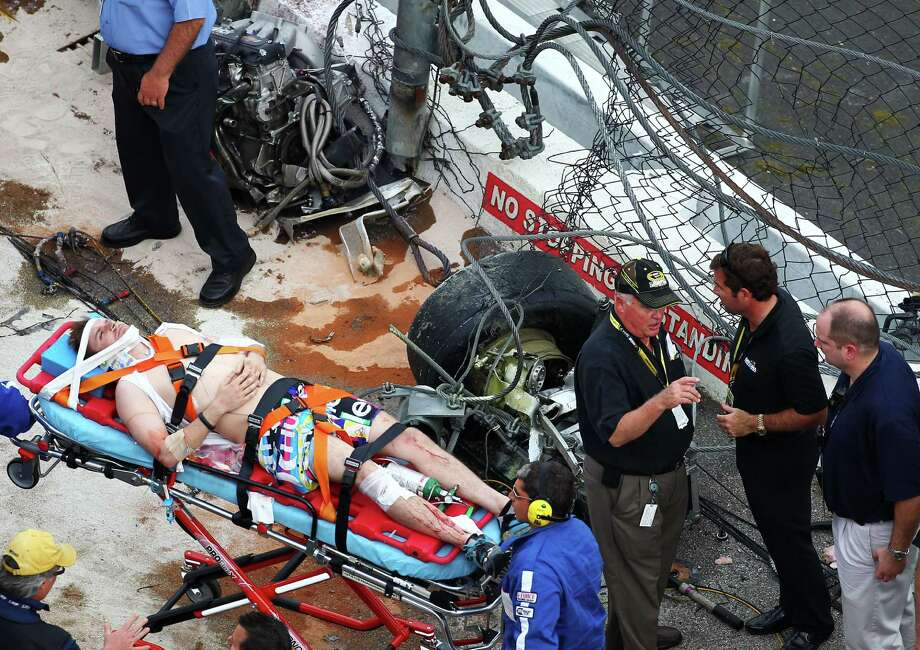 Medical officials remove an injured fan from the stands following an incident at the finish of  the NASCAR Nationwide Series DRIVE4COPD 300 at Daytona International Speedway on February 23, 2013 in Daytona Beach, Florida. Photo: Jonathan Ferrey, Getty Images / 2013 Getty Images