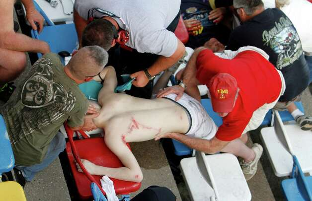 Injured spectators are treated after a crash at the conclusion of the NASCAR Nationwide Series auto race Saturday, Feb. 23, 2013, at Daytona International Speedway in Daytona Beach, Fla. Driver Kyle Larson's car hit the safety fence sending car parts and other debris flying into the stands. Photo: David Graham, Associated Press / FR46423 AP