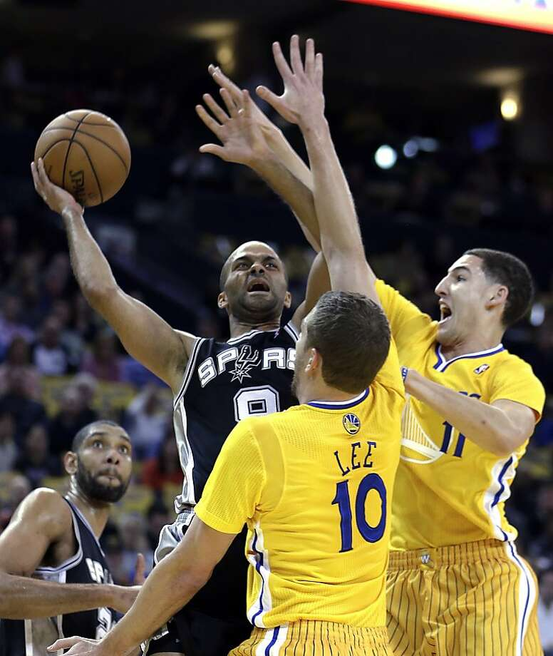 Tony Parker (left) found a formidable defensive opponent in the Warriors, the version without big man Andrew Bogut. Photo: Ben Margot, Associated Press