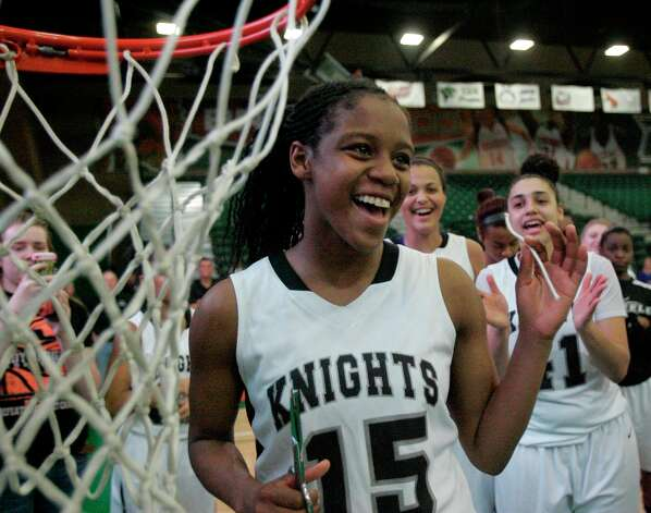 Steele Kyra Lambert cuts the basketball cord after defeating San Antonio Wagner during the girls 5A Regional Finals at the University of Texas Pan American Fieldhouse  in Edinburg on Saturday, Feb. 23, 2013. Photo: Delcia Lopez