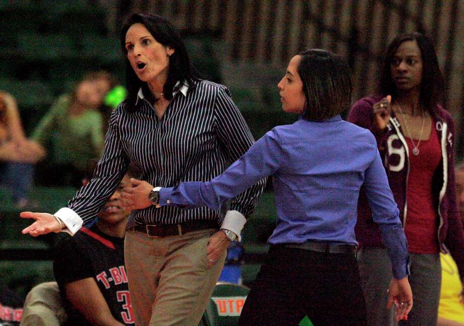 Wagner's coach Christina Camacho is held back by assitant coach Melissa Martinez after arguing a technical of her player against Cibilo Steele during the 5A Regional Finals at the University of Texas Pan American Fieldhouse  in Edinburg on Saturday, Feb. 23, 2013. Photo: Delcia Lopez