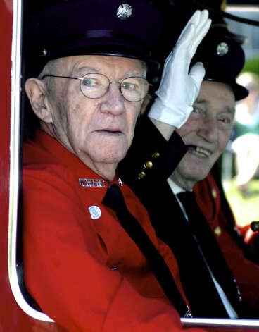 Veteran Water Witch Hose Co. No. 2 firefighters James Hulton, a.k.a. Bud, left, and Rick Onorato enjoy the ride in one of the fire department's trucks during Monday's Memorial Day parade in New Milford. May 26, 2008 Photo: Norm Cummings