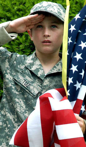 Tristan Tuz, 10, of New Milford offers a heartfelt salute  while serving as an honorary member of the color guard of his town's Memorial Day ceremony and parade. Tristan's older brother, Cody Tuz, is serving his country in Iraq. May 28, 2007 Photo: Norm Cummings