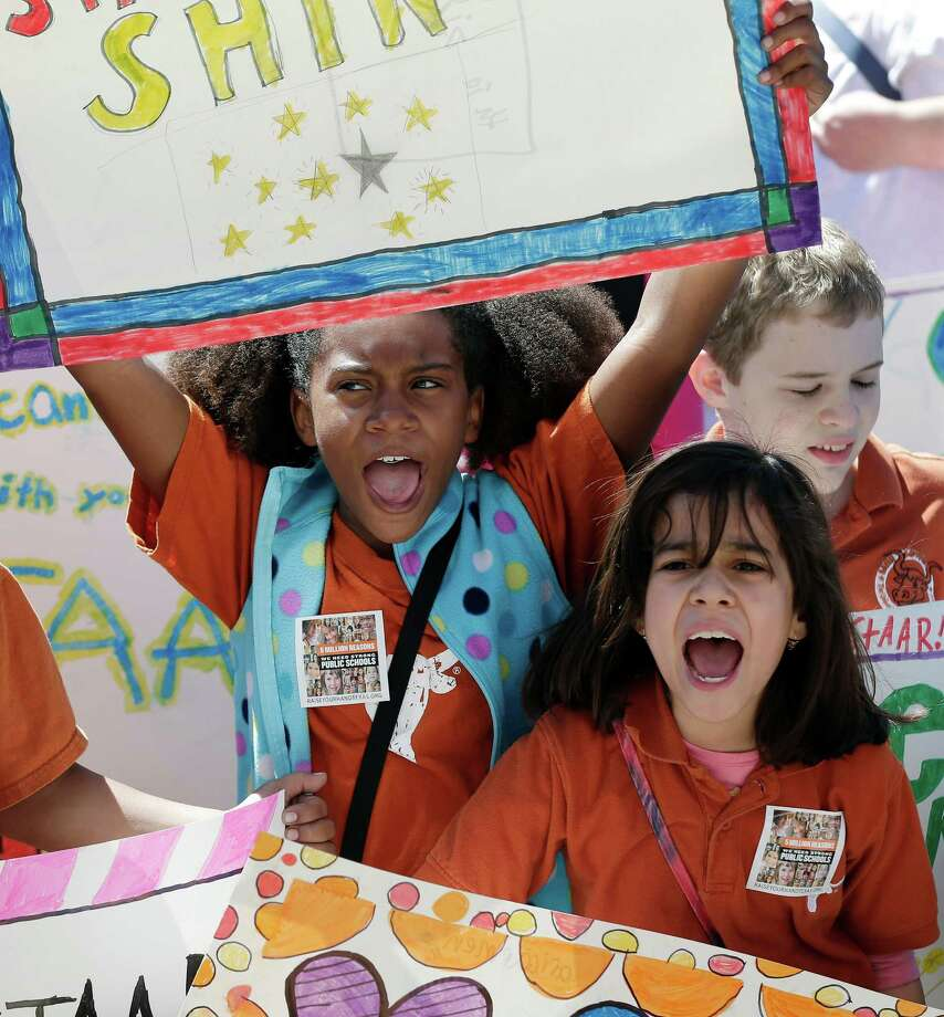 Austin fourth graders Maricaren Marquez, left, and Anastacia Ortega, right, take part in a rally for Texas public schools at the state Capitol, Saturday, Feb. 23, 2013, in Austin, Texas. Photo: Eric Gay, Associated Press / AP