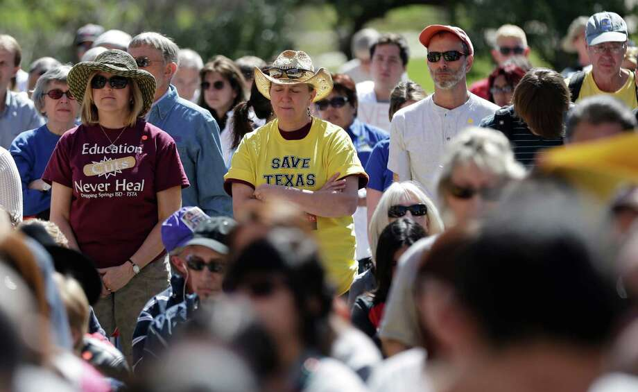 Teachers, students, parents and school administrators pause for an invocation as they take part in a rally for Texas public schools at the state Capitol, Saturday, Feb. 23, 2013, in Austin, Texas. Photo: Eric Gay, Associated Press / AP