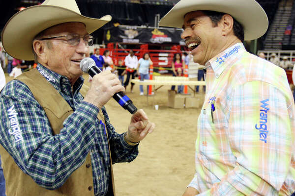 FOR METRO - Rodeo Announcers Hadley Barrett (left) and Randy Corley share a laugh while announcing the Exceptional Rodeo during 60th annual San Antonio Stock Show & Rodeo held Friday Feb. 13, 2009 at the AT&T Center. (PHOTO BY EDWARD A. ORNELAS/eaornelas@express-news.net)