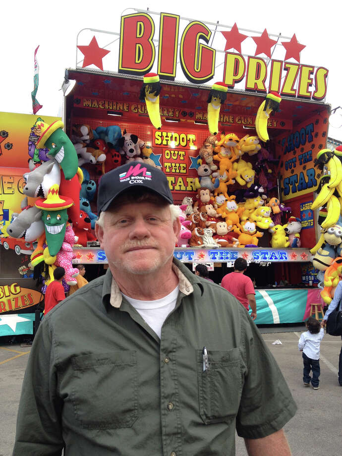 "Thomas ""Red"" Cox stands in front of one of the game booths he bought with his 2008 lotto winnings. Cox manages the carnival at the San Antonio Stock Show & Rodeo. Photo: Sarah L Tressler, San Antonio Express-News / San Antonio Express-News"