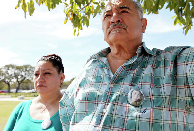 "Jessica Rivera (left) and her husband Rudy Rivera Jr. attend the burial of Rudy's niece Brandeis High School junior Gabriella ""Gabby"" Lerma Saturday Feb. 23, 2013 at Resurrectuon Cemetery. Lerma, 17, died in a car crash Tuesday that also claimed the life of Brandeis High School student Georgina ""Gina"" Rodriguez, 16. Photo: Edward A. Ornelas, San Antonio Express-News / © 2013 San Antonio Express-News"