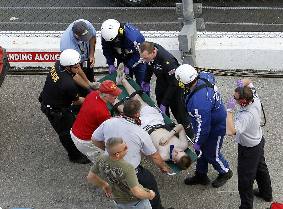 Spectators are injured after a tire and engine off Kyle Larson's car flew into the stands during a crash at the conclusion of the NASCAR Nationwide Series auto race Saturday, Feb. 23, 2013, at Daytona International Speedway in Daytona Beach, Fla. (AP Photo/David Graham) Photo: David Graham, Associated Press