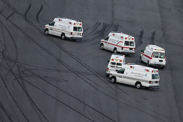 DAYTONA BEACH, FL - FEBRUARY 23: Ambulances sit on the track after emergency officials responded to an incident at the finish of the NASCAR Nationwide Series DRIVE4COPD 300 at Daytona International Speedway on February 23, 2013 in Daytona Beach, Florida.  (Photo by Jonathan Ferrey/Getty Images) Photo: Jonathan Ferrey, Getty Images