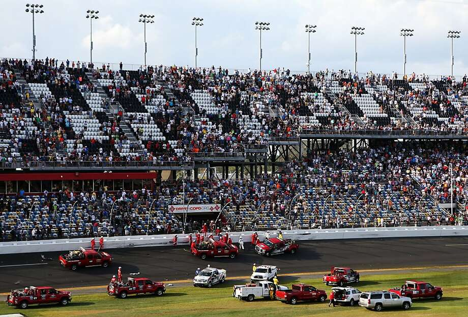 DAYTONA BEACH, FL - FEBRUARY 23: Emergency officials respond to an incident that sent debris into the stands at the finish of the NASCAR Nationwide Series DRIVE4COPD 300 at Daytona International Speedway on February 23, 2013 in Daytona Beach, Florida.  (Photo by Matthew Stockman/Getty Images) Photo: Matthew Stockman, Getty Images