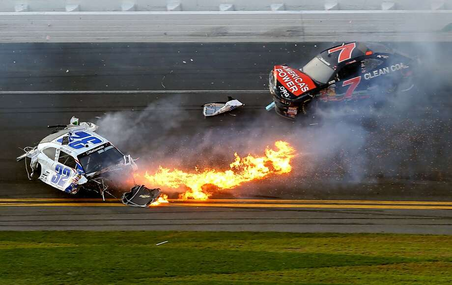 DAYTONA BEACH, FL - FEBRUARY 23:  Kyle Larson, driver of the #32 Clorox Chevrolet, and Regan Smith, driver of the #7 Clean Coal Chevrolet, are involved in an incident at the finish of the NASCAR Nationwide Series DRIVE4COPD 300 at Daytona International Speedway on February 23, 2013 in Daytona Beach, Florida.  (Photo by Matthew Stockman/Getty Images) Photo: Matthew Stockman, Getty Images