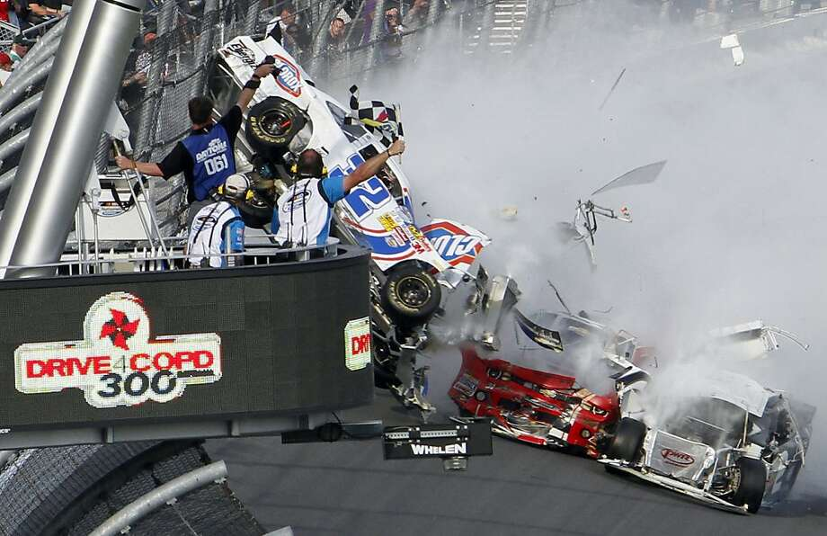 Kyle Larson's car (32) gets airborne during a multi-car wreck on the final lap of the NASCAR Nationwide Series auto race Saturday, Feb. 23, 2013, at Daytona International Speedway in Daytona Beach, Fla. (AP Photo/David Graham) Photo: David Graham, Associated Press