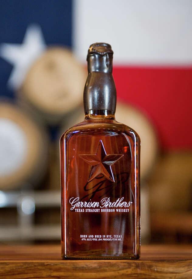A bottle of Garrison Bros. bourbon whiskey is displayed in the barrel barn at Garrison Bros. Distillery in Hye, TX on Sat., Jan 12, 2013. Ashley Landis for the Houston Chronicle Photo: Ashley Landis, For The Houston Chronicle / copyright 2013 Ashley Landis