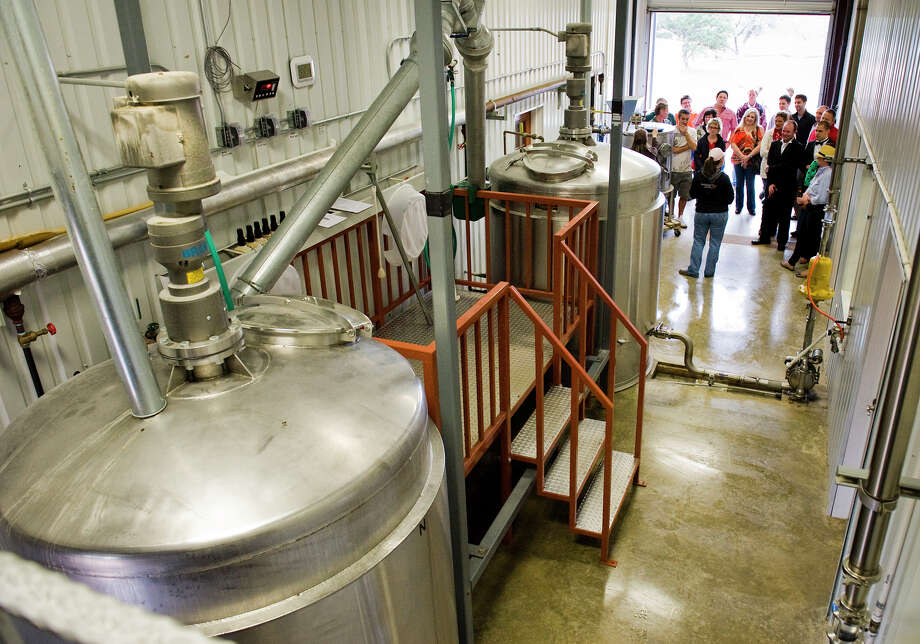 A tour group is lead through the mixing room, where bourbon's raw ingreadiants - corn, wheat, rye and barley - are mixed with water and yeast, at Garrison Bros. Distillery in Hye, TX on Sat., Jan 12, 2013. Photo: Ashley Landis, For The Houston Chronicle / copyright 2013 Ashley Landis