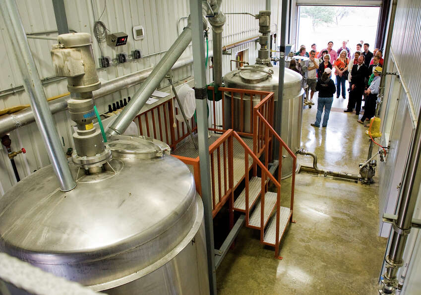 A tour group is lead through the mixing room, where bourbon's raw ingreadiants - corn, wheat, rye an
