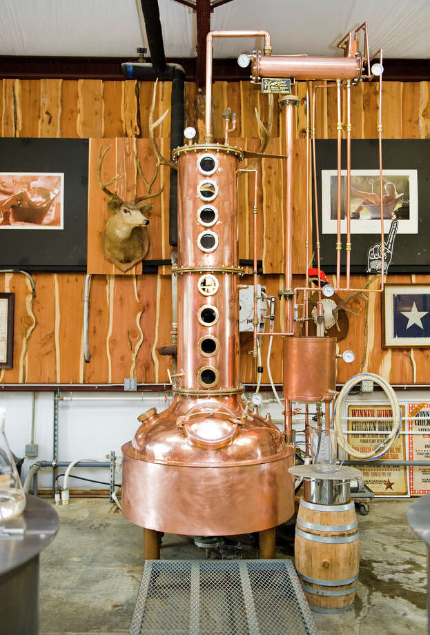 """""""Copper Cowgirl,"""" the first 100 gallon still at Garrison Bros. Distillery in Hye, TX is the center focal point of the still room on Sat., Jan 12, 2013.  The facility now houses two 500 gallon stills. Photo: Ashley Landis, For The Houston Chronicle / copyright 2013 Ashley Landis"""