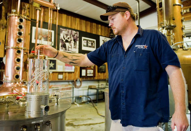 "Master distiller/distillery director Donnis Todd checks on the progress of a batch of ""white dog,"" firmented bourbon before it's been aged, at Garrison Bros. Distillery in Hye, TX on Sat., Jan 12, 2013. Photo: Ashley Landis, For The Houston Chronicle / copyright 2013 Ashley Landis"