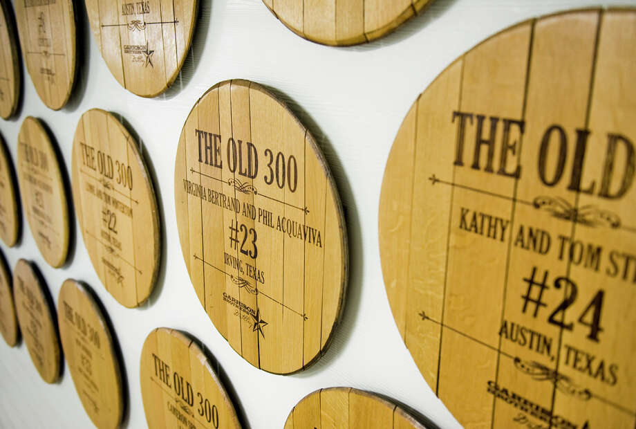 Names of the Old 300 club are displayed on the wall in the fermenting room at Garrison Bros. Distillery in Hye, TX on Sat., Jan 12, 2013.  Old 300 club members help finance the distillery one barrel at a time and are offered a case of bourbon, their own barrel, participation in bourbon camp at the facility, among other bourbon-related privileges. Photo: Ashley Landis, For The Houston Chronicle / copyright 2013 Ashley Landis