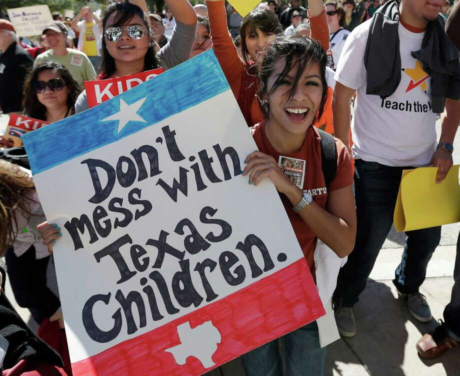 Teachers, students, parents and school administrators take part in a rally Saturday for Texas public schools at the state Capitol. About 2,000 people called for funds to be restored and for less emphasis on testing. Photo: Eric Gay, STF / AP