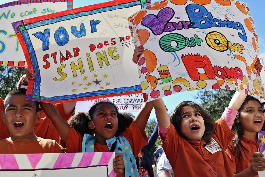 "John Estrada, 9, from left, Marlee Foster, 10, Maricarmen Marquez, 9, and Anastacia Ortega, 9, chant ""Save Our Schools"" during the Save Texas Schools Rally after they marched to the Texas State Capitol in Austin on Saturday, Feb. 23, 2013. The children are all in the same fourth grade class at UT Elementary School in Austin. Photo: Lisa Krantz, San Antonio Express-News / San Antonio Express-News"