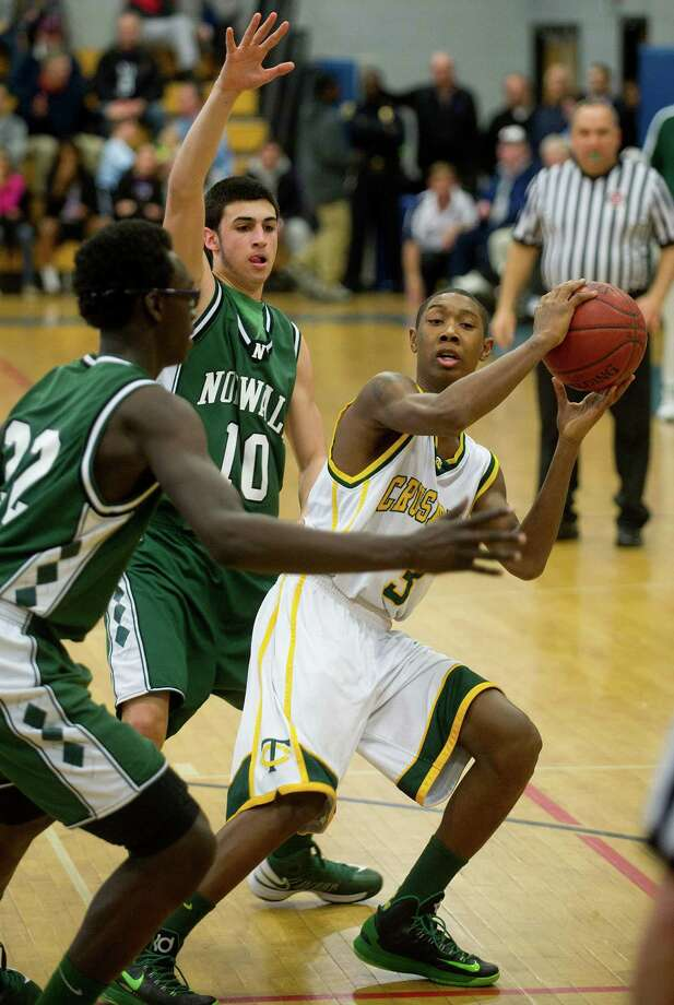 Trinity Catholic's Tremaine Frasier controls the ball during Saturday's FCIAC quarterfinal game at Fairfield Ludlowe High school on February 23, 2013. Photo: Lindsay Perry / Stamford Advocate
