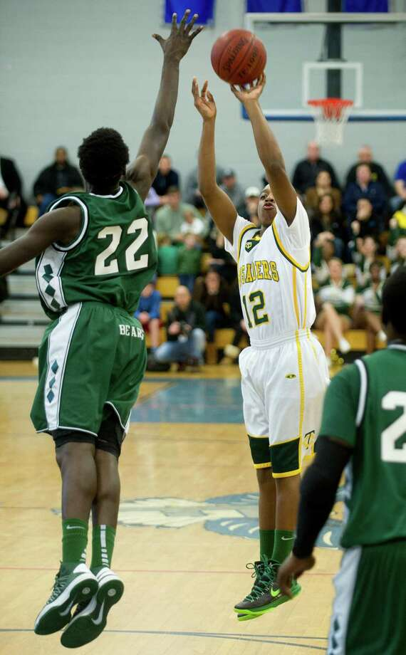 Trinity Catholic's Tyrell St. John takes a shot during Saturday's FCIAC quarterfinal game at Fairfield Ludlowe High school on February 23, 2013. Photo: Lindsay Perry / Stamford Advocate