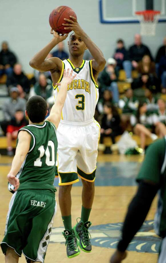 Trinity Catholic's Tremaine Frasier takes a shot during Saturday's FCIAC quarterfinal game at Fairfield Ludlowe High school on February 23, 2013. Photo: Lindsay Perry / Stamford Advocate