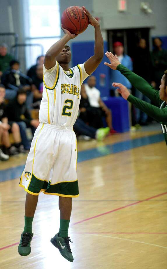 Trinity Catholic's Shadrac Casimir takes a shot during Saturday's FCIAC quarterfinal game at Fairfield Ludlowe High school on February 23, 2013. Photo: Lindsay Perry / Stamford Advocate