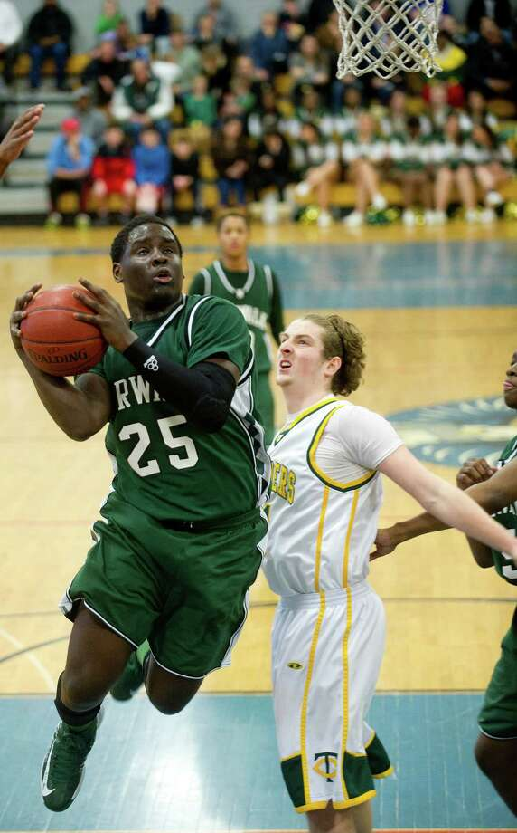 Norwalk's Saeed Soulemane takes a shot during Saturday's FCIAC quarterfinal game at Fairfield Ludlowe High school on February 23, 2013. Photo: Lindsay Perry / Stamford Advocate