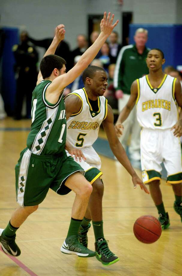 Trinity Catholic's Brandon Wheeler controls the  ball during Saturday's FCIAC quarterfinal game at Fairfield Ludlowe High school on February 23, 2013. Photo: Lindsay Perry / Stamford Advocate