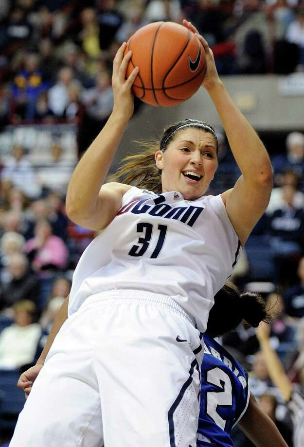 Connecticut's Stefanie Dolson is fouled by Seton Hall's Brittany Morris during the first half of an NCAA college basketball game in Storrs, Conn., Saturday, Feb. 23, 2013. (AP Photo/Fred Beckham) Photo: Fred Beckham, Associated Press / FR153656 AP