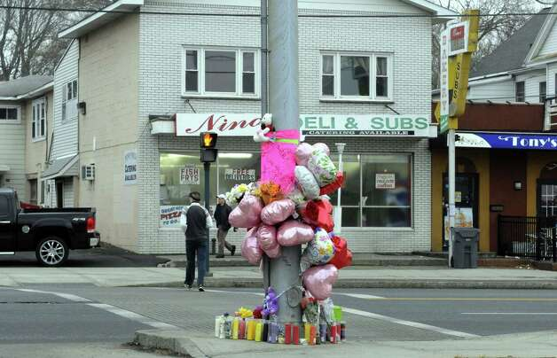 A memorial set up on corner in memory of Katherine Parker an Albany woman who died after being hit by a car near this spot at King and Central Avenues on Saturday Feb. 23, 2013 in Albany, N.Y. (Michael P. Farrell/Times Union) Photo: Michael P. Farrell