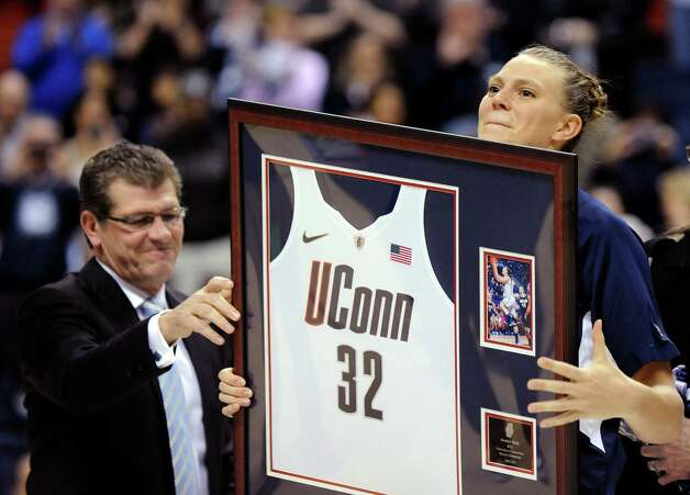 Heather Buck, receives an award from Geno Auriemma during Senior Night ceremonies before Connecticut's NCAA basketball game against Seton Hall in Storrs, Conn., Saturday, Feb. 23, 2013. (AP Photo/Fred Beckham) Photo: Fred Beckham, Associated Press / FR153656 AP