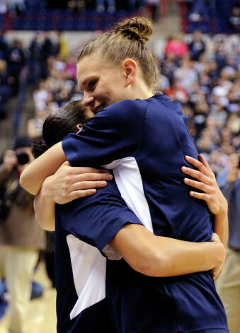 Heather Buck, right, hugs Bria Hartley during Senior Night ceremonies before Connecticut's NCAA basketball game against Seton Hall in Storrs, Conn., Saturday, Feb. 23, 2013. (AP Photo/Fred Beckham) Photo: Fred Beckham, Associated Press / FR153656 AP