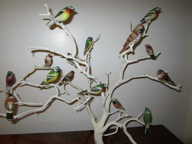 A folk art bird tree, circa 1930s, with various hand-carved, gaily painted wood birds, is among the items Find Weatherly, LLC, will have on display at the 46th annual Darien Antiques Show. Photo: Contributed