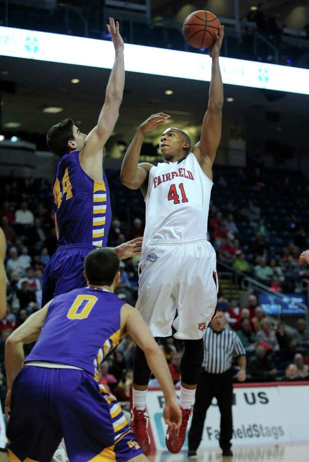 Fairfield's Keith Matthews puts up the ball as Albany's John Puk defends Saturday, Feb. 23, 2013 at the Webster Bank Arena in Bridgeport, Conn. Photo: Autumn Driscoll / Connecticut Post