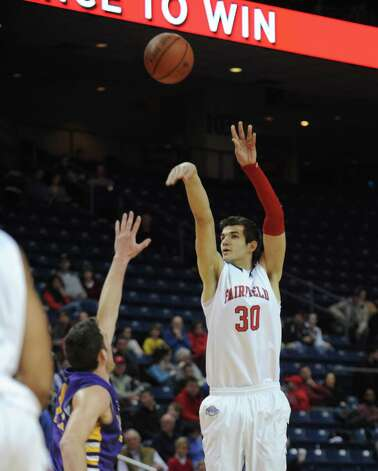 Fairfield's Josip Mikulic puts up the ball during game action against the University of Albany Saturday, Feb. 23, 2013 at the Webster Bank Arena in Bridgeport, Conn. Photo: Autumn Driscoll / Connecticut Post