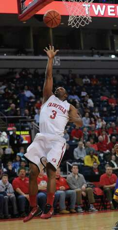 Fairfield's Derek Needham puts up the ball during game action against the University of Albany Saturday, Feb. 23, 2013 at the Webster Bank Arena in Bridgeport, Conn. Photo: Autumn Driscoll / Connecticut Post