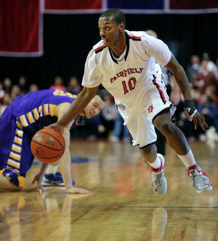 Fairfield's Justin Jenkins drives the ball down the court during game action against the University of Albany Saturday, Feb. 23, 2013 at the Webster Bank Arena in Bridgeport, Conn. Photo: Autumn Driscoll / Connecticut Post