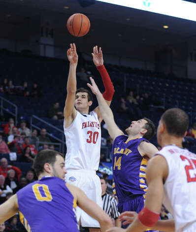 Fairfield's Josip Mikulic puts up the ball as Albany's Sam Rowley defends Saturday, Feb. 23, 2013 at the Webster Bank Arena in Bridgeport, Conn. Photo: Autumn Driscoll / Connecticut Post