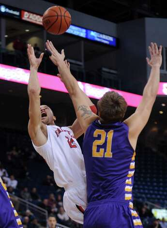 Fairfield's Colin Nickerson gets fouled by Albany's Blake Metcalf Saturday, Feb. 23, 2013 at the Webster Bank Arena in Bridgeport, Conn. Photo: Autumn Driscoll / Connecticut Post